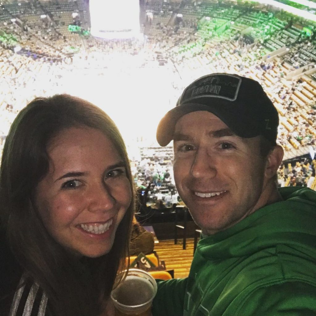 Woman and man at the Boston Celtics game
