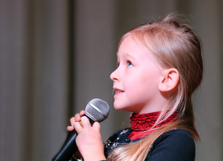 Young girl singing on stage