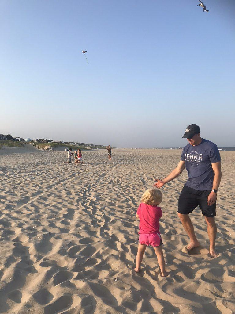 Family flying kites on the beach