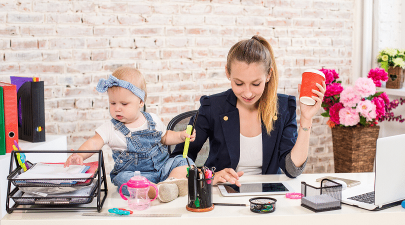 Working mom with baby at a desk