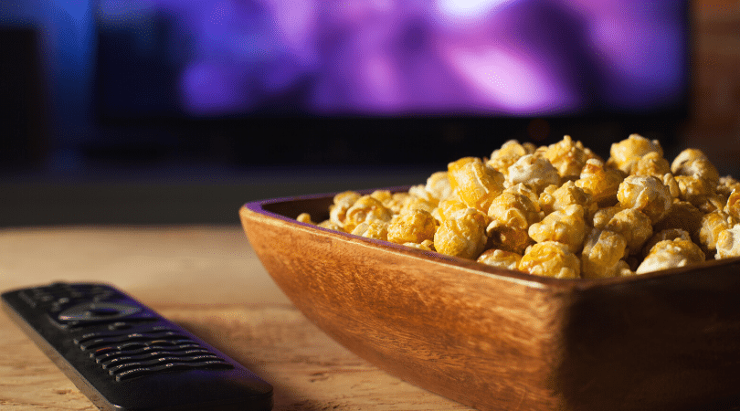 Bowl of popcorn and tv remote