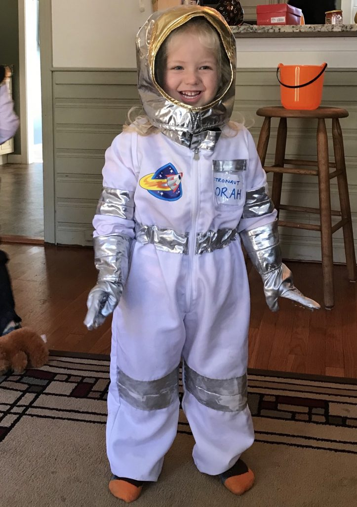 Little girl in astronaut costume