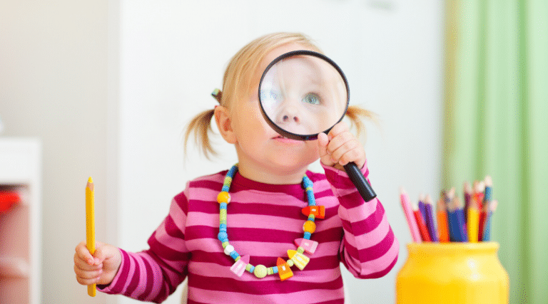 Toddler Looking Through Magnifying Glass