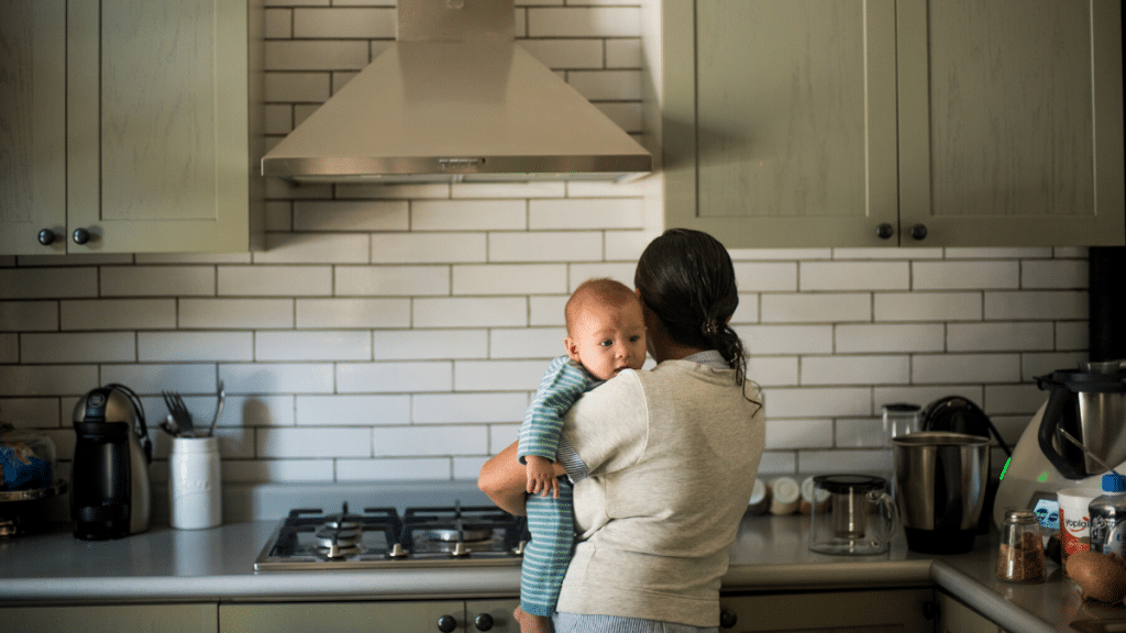 What is mom guilt? Mom in kitchen with baby.
