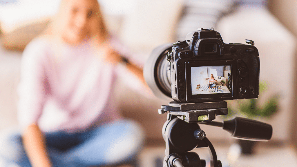 Woman filming a video with a tripod