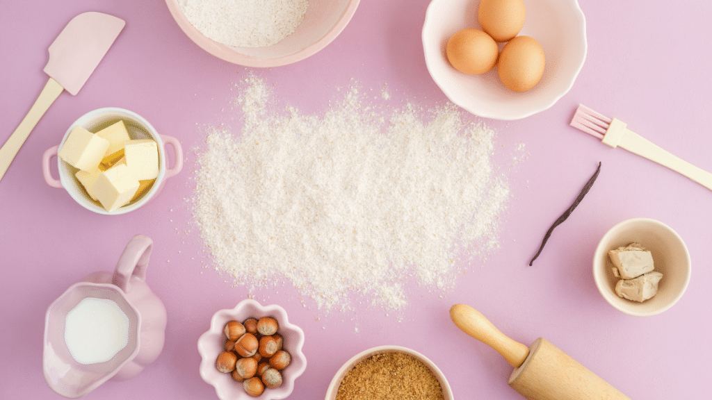 Pink background with baking supplies
