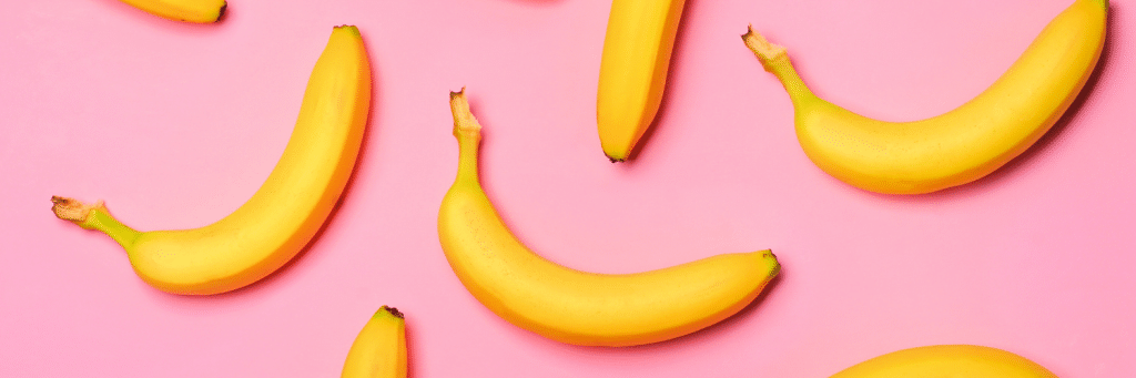 pink background with bananas