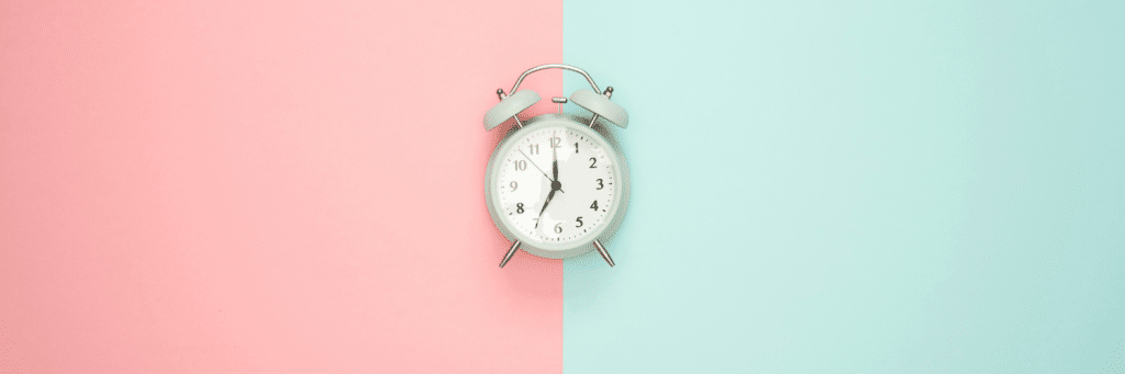 pink and light green background with clock