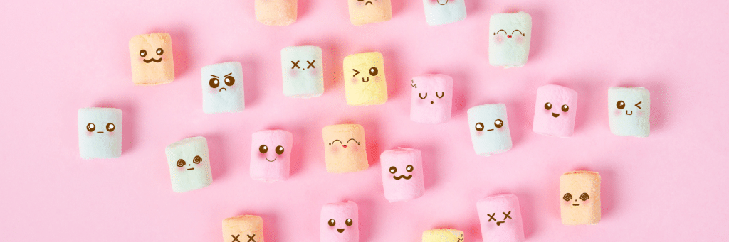 pink background, marshmallows with faces drawn on
